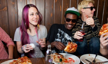 Hanging out eating pizza